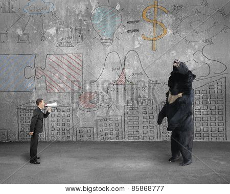 Businessman Using Megaphone Yelling At Black Bear With Doodles Wall