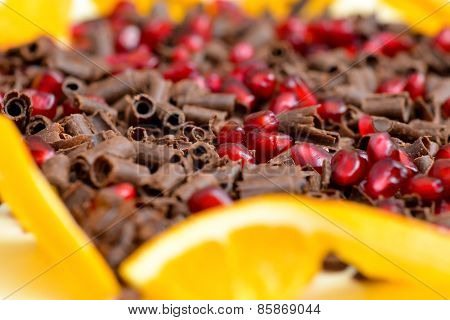 Closeup Of Milk Chocolate Chips And Pomegranate Mix