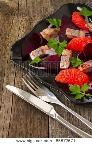 Dish With A Salad Of Herring, Beetroot And Grapefruit