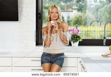 Sensual Blond At Home Drinking From Cup