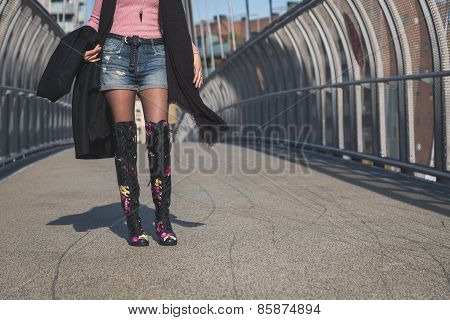 Detail Of A Beautiful Young Brunette Posing On A Bridge