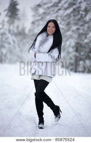 Young Woman In Winter Forest