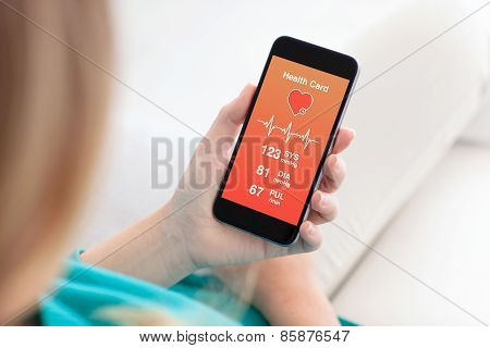 Woman Holding A Phone With App For Health Card Monitoring