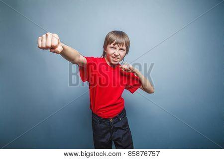 Boy, teenager, twelve his years  red  in shirt