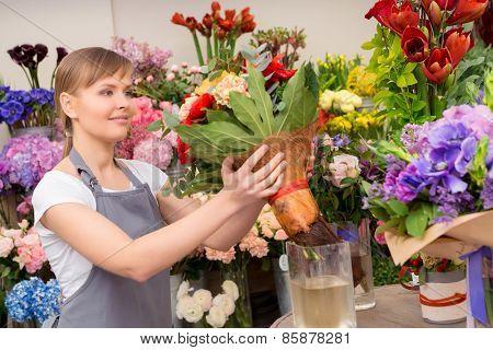 Florist puts bouquet into the vase