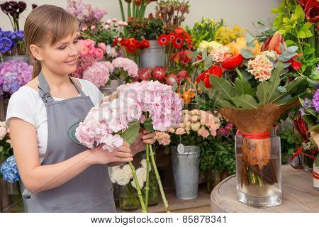 Florist puts bouquet into the vase