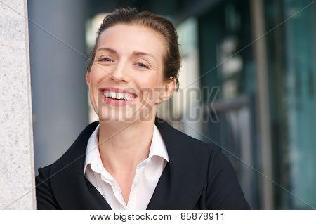 Close Up Portrait Of A Friendly Business Woman Smiling
