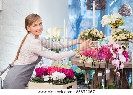 Florist by the flower pots