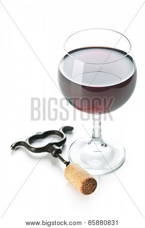 the glass of red wine and corkscrew