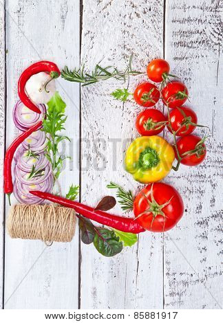 Border of healthy Bio Vegetables on a Wooden Background