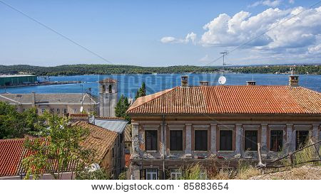City Of Pula Skyline And Harbor View  In Summer