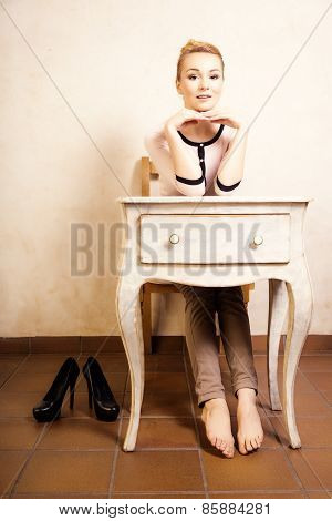 Vintage Style. Barefoot Girl Sitting At Retro Desk