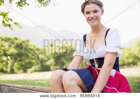 Pretty oktoberfest girl smiling at camera on a sunny day