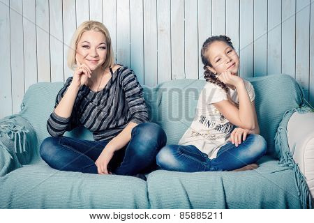 Daughter and mother on the sofa