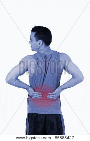 Portrait of a man having a back pain against a white background