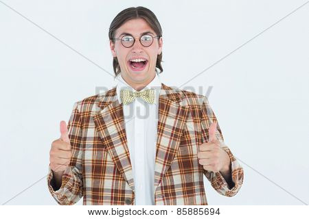 Smiling geeky hipster smiling at camera on white background