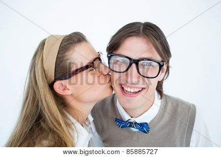 Geeky hipster kissing her boyfriend on white background