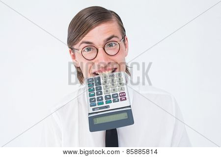 Geeky smiling businessman biting calculator on white background