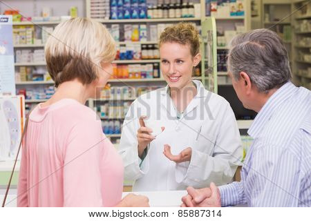 Pharmacist and sick customer speaking in the pharmacy