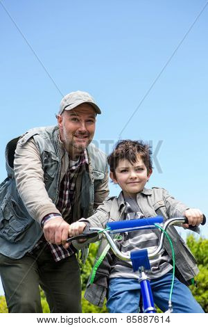 Father and son on a bike ride in the countryside