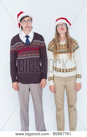 Sad geeky hipster couple on white background