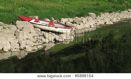Little Row Boat On The Shore