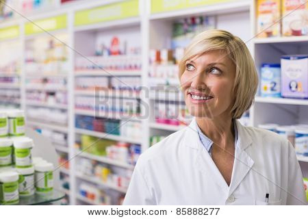 Pharmacist looking up at pharmacy