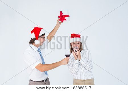Happy geeky hipster couple drinking red wine on white background