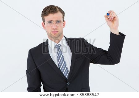Geeky businessman writing with marker on white background