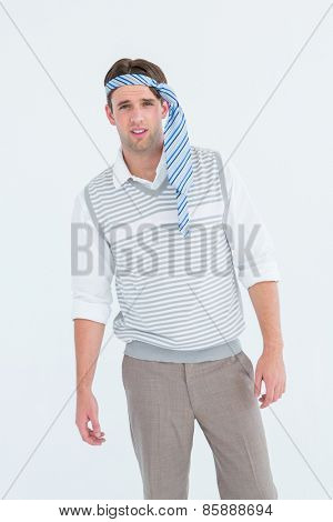 Geeky man with tie on his head on white background