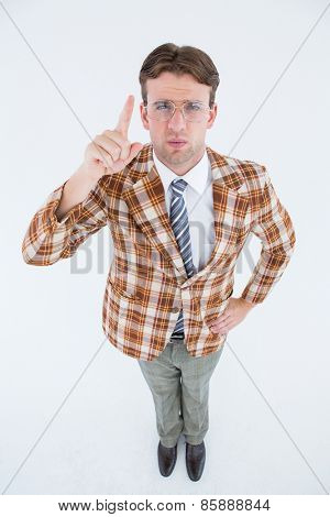 Upset geeky hipster pointing at camera on white background