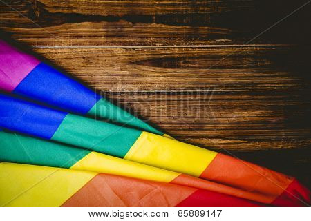 Gay pride flag on wooden table shot in studio