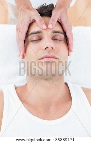 Man receiving head massage in medical office