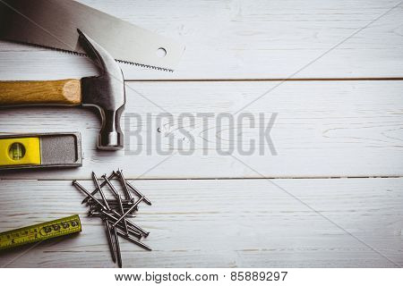 Hammer and nails laid out on table shot in studio