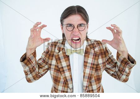 Furious geeky hipster looking at camera on white background