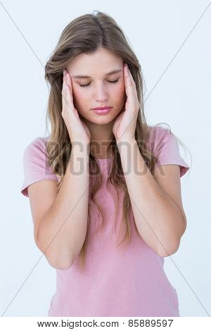 Pretty woman with headache hands on temples on white background