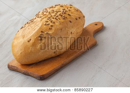 A Loaf Of Rye Bread Sunflower Seeds On A Cutting Board