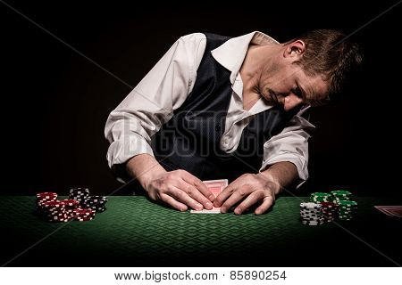 Gambler Checks The Cards
