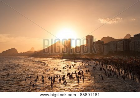 Crowded Copacabana Beach by Sunset in Rio de Janeiro, Brazil