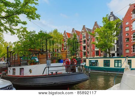 Amsterdam canal with picturesque houseboats, Holland, Netherlands