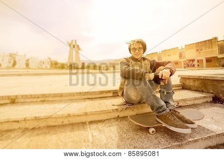 Young Rasta Guy Outdoor On Skateboard With A Warm Filter Applied