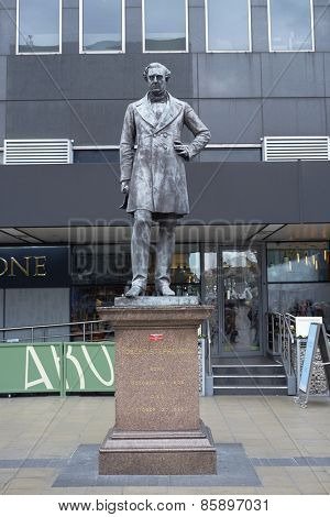 LONDON, UK - MARCH 21: Statue of railway engineer Robert Stephenson at Euston Station. March 21, 2015 in London. Stephenson is considered to be the greatest engineer of the 10th century.