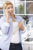 stock photo of cell block  - Frustrated Woman Calling Plumber To Fix Blocked Sink At Home - JPG