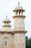 stock photo of mughal  - Minarets at the Tomb of I timad ud Daulah in Agra Uttar Pradesh India a Mughal mausoleum often described as the Baby Taj or jewel box - JPG