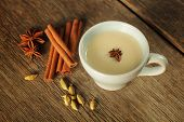 picture of cinnamon  - Blue cup with chai tea with cinnamon - JPG