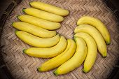 foto of festering  - Ripe bananas on a bamboo tray stock photo - JPG