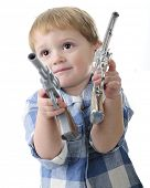 image of guns  - Close up of an adorable two year old playing cowboy with a gun in each hand - JPG