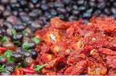 image of pimiento  - Dry peppers in oil and seasoned black olives in a sicilian weekly market - JPG