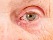 picture of sad eyes  - Close up photo of elderly woman eye - JPG
