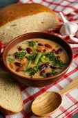 stock photo of fresh slice bread  - Bean soup in bowl with fresh sliced bread on napkin - JPG